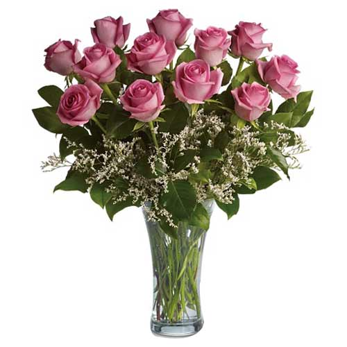 Graceful Pink Roses placed in a Glass Vase