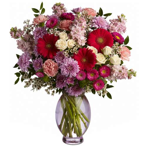 Impressive Multicolored Floral Assortments beautified in a Glass Vase<br>