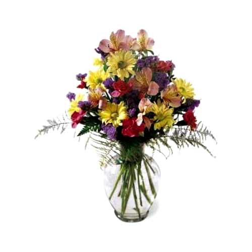 Tender Mixed Florals placed in a Glass Vase