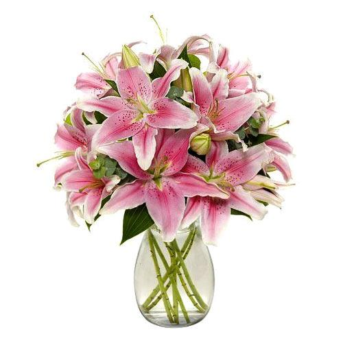 Dazzling Mixed Florals arranged in a Glass Vase<br>
