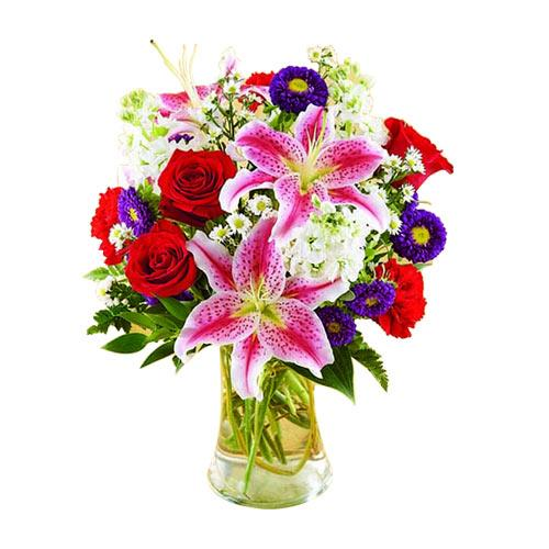 Aromatic Multicolored Floral Assortments beautified in a Glass Vase